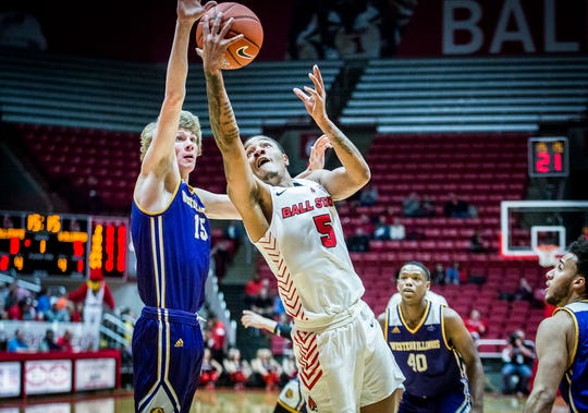 Ball State's Ishmael El-Amin struggles past Western Illinois' defense during their game at Worthen Arena Tuesday, Nov. 26, 2019. Western Illinois defeated Ball State 69-62.