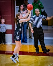 Central Magnet's Olivia Hart buries the game-winning shot in a 38-37 win over Eagleville Tuesday.