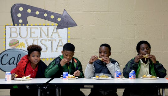 Buena Vista Elementary School students Kymarie Scales, left, Lasean Bonds, Montrell Leggs, and Ky'Lan Hutcherson eat a late afternoon meal on Thursday, Nov. 21, 2019, in Nashville, Tenn. The YMCA of Middle Tennessee provides 213,000 late afternoon meals for Nashville public school students before they go home for the day. The YMCA also provides 24,574 breakfasts and lunches for the children during the summer.
