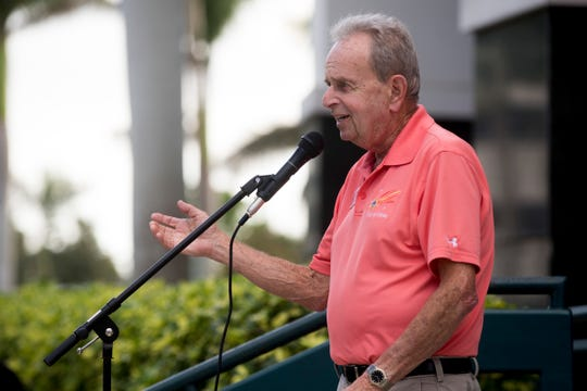 Bill Barnett speaks to a large crowd of gun reform advocates during a protest and march at the Collier County Courthouse Feb. 23, 2018, in Naples.