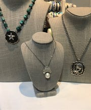 These sterling extenders at the Marco Island Historical Museum store, are, from left, $129, $49 and $159. (The chains are sold separately and range from $29 to $39).  Local artist Nancy Judd created all three.