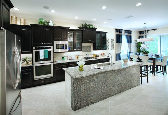 Azure at Hacienda Lakes is offering a 2,842 square-foot, move-in ready Athena Caribbean home featuring three bedrooms, two and one-half bathrooms, a gourmet kitchen, and a three-car garage.