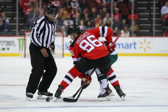 Nov 26, 2019; Newark, NJ, USA; New Jersey Devils center Jack Hughes (86) takes a face-off during the first period of their game against the Minnesota Wild at Prudential Center.