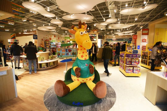 General scene of the store front and Geoffrey, the brand's giraffe mascot is seen during the grand opening at Garden State Plaza Mall in Paramus on 11/27/19.