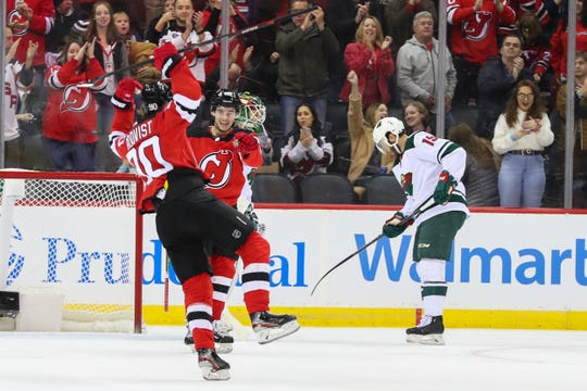 Nov 26, 2019; Newark, NJ, USA; New Jersey Devils center Jesper Boqvist (90) scores his 1st NHL goal during the first period of their game against the Minnesota Wild at Prudential Center.