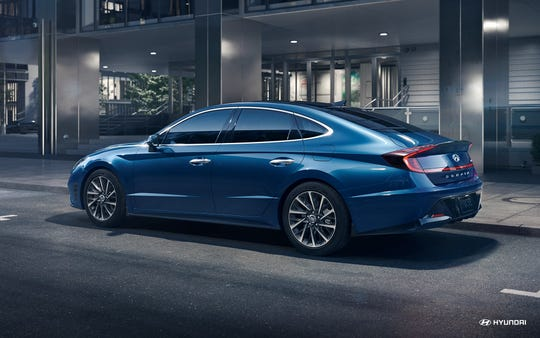 The exterior of the 2020 Hyundai Sonata sports striking styling elements, including front and rear LED light treatments and side body trim highlighted by an inch-wide chrome strip that runs from the headlights up and over the hood and window frames.