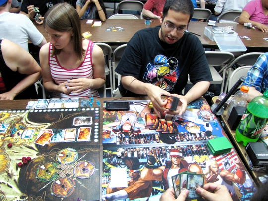 Customers open board game tables at Time Warp Comics