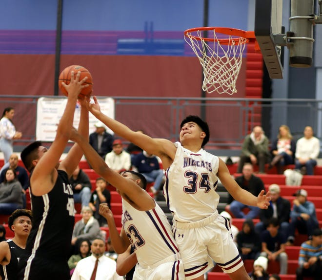 Junior Wildcat post Christian Pacheco (34) provided a strong inside game for the Wildcats during Tuesday's 52-48 loss to the visiting Chaparral High Lobos.