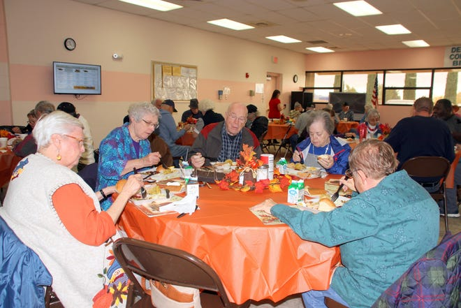 1st New Mexico Bank in Deming kept with tradition and fed over 400 senior citizens on Tuesday at the Deming Senior Citizen's Center, 800 S. Granite Street. The bank employees and their families handled the serving of a full Thanksgiving dinner that included mashed potatoes, turkey, cranberry, vegetables, dinner rolls, coffee and tea, and pumpkin or pecan pie. The bank has catered this meal for the past 23 years.