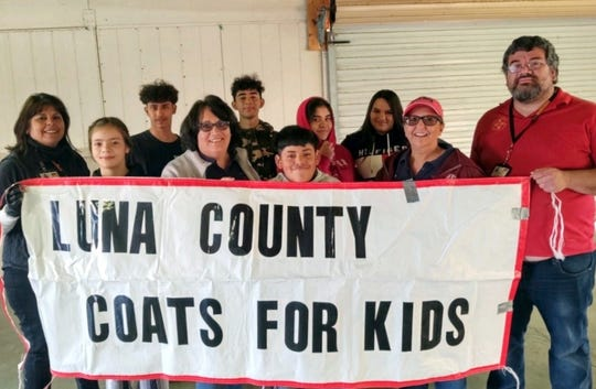 Teen volunteers from the Juvenile Probation Office stand with Luna County Coats for Kids committee members during the coats distribution event held on Saturday, Nov. 23 at the Luna County Courthouse Park. The program distributed over 320 winter coats to children in Deming and Columbus.