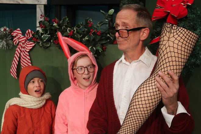 "Frank Parker (played by Brandon Brown) admires his new lamp as his sons Ralphie (Carter Chamberlin), and Randy (Waylon Yerxa), look on in this scene from ""A Christmas Story: The Musical,"" opening Dec. 6 at the Las Cruces Community Theatre."