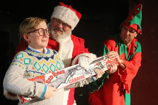 """Ralphie (played by Carter Chamberlin) fights to hold on to his Red Ryder BB gun as Santa (Gale Fulte) and his elf (Jason Wyatt) try to take it away from him in this scene from """"A Christmas Story: The Musical,"""" opening Friday, Dec. 6, at the Las Cruces Community Theatre."""