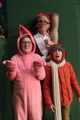 """Frank Parker (played by Brandon Brown), with his sons Ralphie (Carter Chamberlin) and Randy (Waylon Yerxa), in a scene from """"A Christmas Story: The Musical,"""" opening Friday, Dec. 6, at the Las Cruces Community Theatre."""
