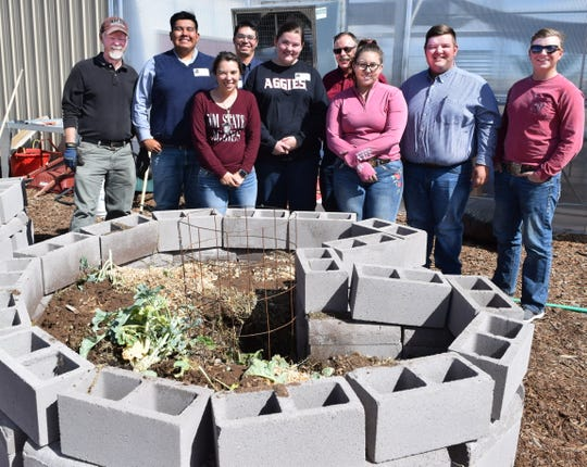 New Mexico State University students helped build a keyhole garden at NMSU's Extension and Research Youth Agricultural Science Center at Las Vegas City Schools. Pictured are, front from left, Suzanne Hopkins, Madalyn Cole and Rahime Jarvis. Back from left, Peter Skelton, NMSU professor and director of the youth agricultural science center; Marcus Magdalena, Gabriel Doherty, Tom Dormody, NMSU professor agricultural and extension education; Jake Devine and Justin Armstrong.
