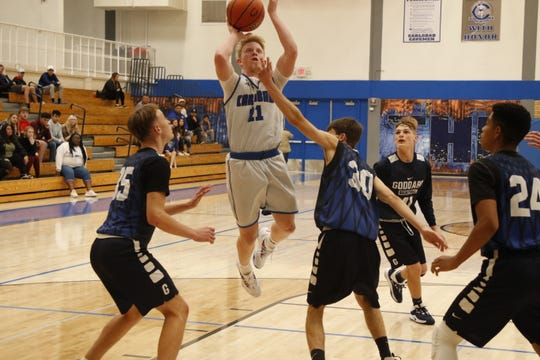 Carlsbad junior Andrew Miller takes a contested jump shot in traffic against Goddard during their scrimmage on Nov. 26, 2019. Carlsbad opens its season Dec. 3 hosting El Paso Americas.