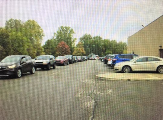 Crowded and unsafe parking situations like this one at Erikkson Elementary School would be alleviated by a successful bond.