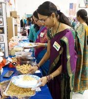 Uthra Vathsai tries a rice dish at the ESL Thanksgiving gathering on Nov. 27.