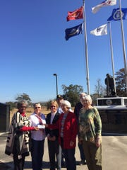 Members of the St. Landry Parish chapter of the Daughters of the American Revolution presented Patricia Mason-Guillory (left) with a $500 check to help reattach granite panels which have begun falling at the parish Veterans Memorial Park. The panels contain the names of all the parish war veterans who have died in combat since World War I. Representing the DAR are Carolyn Jarrell, Barbara Johnson and Jo Ann Caillouet.