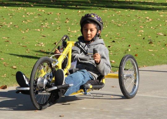 Bill makes his way in a three-wheeler.
