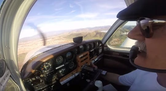 In a frame grab from a YouTube video,  Canyon Lake resident John Brent Stackhouse, 67, flies over Anza and lands his classic Beechcraft airplane in February 2017.