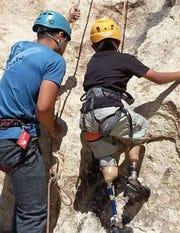 Damien climbs a mountain in Joshua Tree.