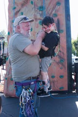 Asher gets ready for the rock-climbing wall.