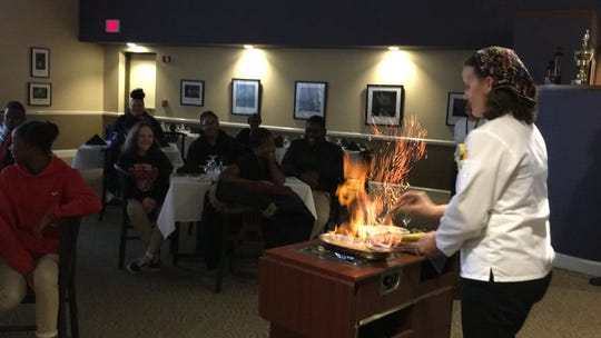 PSC culinary instructor Joni Verlin creates Bananas Foster for students from Dixon School of Arts & Sciences.