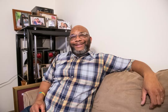 Jacques Merine poses for a portrait in the living room of his Mount Joy Township home on Tuesday, Nov. 19, 2019. Merine is a founder and director of the nonprofit organization, Source of Life Ministries.