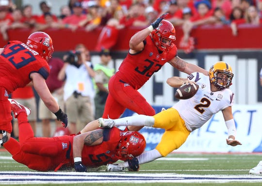 Nov 28, 2014: Arizona State Sun Devils quarterback Mike Bercovici (2) is tackled by Arizona Wildcats linebacker Scooby Wright III (33) in the fourth quarter during the Territorial Cup at Arizona Stadium. The Wildcats defeated the Sun Devils 42-35 to win the Pac-12 south title.