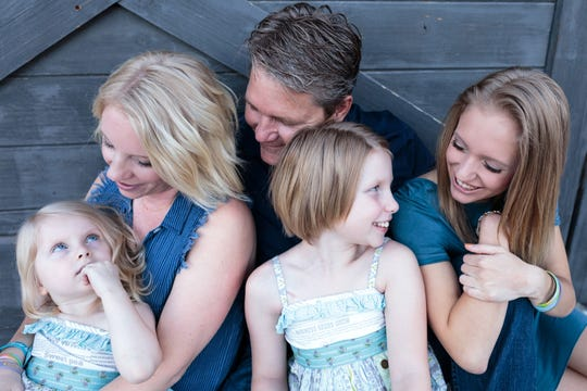 The Bentley family, parents Nikkole and Rod, and daughters Ariya, 5; Abri, 11, and Ashlyn, 19.