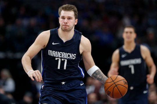 Dallas Mavericks forward Luka Doncic (77) advances the ball up court during an NBA basketball game against the Golden State Warriors in Dallas, Wednesday, Nov. 20, 2019. (AP Photo/Tony Gutierrez)