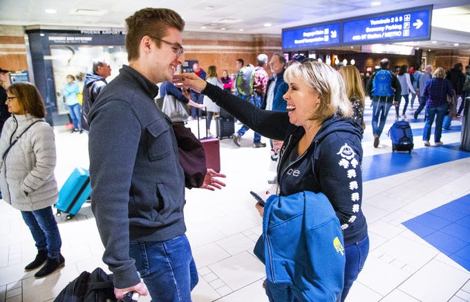 Deb Fedasiuk greets her son, Ryan, at Sky Harbor International Airport Terminal 4 on Nov. 27, 2019.  Ryan came home for Thanksgiving from Washington, D.C..
