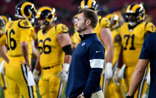 Los Angeles Rams head coach Sean McVay watches his team warm up before playing the Baltimore Ravens at Los Angeles Memorial Coliseum.