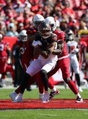 Arizona Cardinals outside linebacker Haason Reddick (43) and middle linebacker Jordan Hicks (58) tackle Tampa Bay Buccaneers wide receiver Mike Evans (13) during the first quarter at Raymond James Stadium earlier this season.