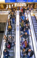 Passengers make their way through Sky Harbor International Airport Terminal 4 on Nov. 27, 2019.