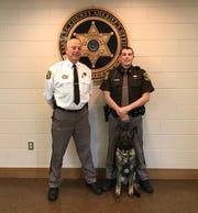 Sanilac County Sheriff Gary Biniecki  (left) and Deputy James Anderson with Zuzana, Sanilac County's first jail dog.