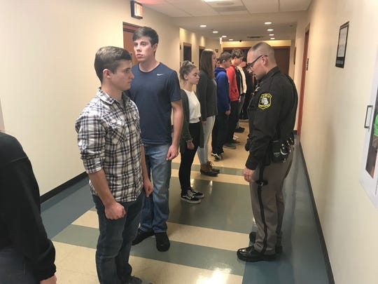 St. Clair County Sheriff Deputy Carl Wilczak tests students on a marching maneuver.