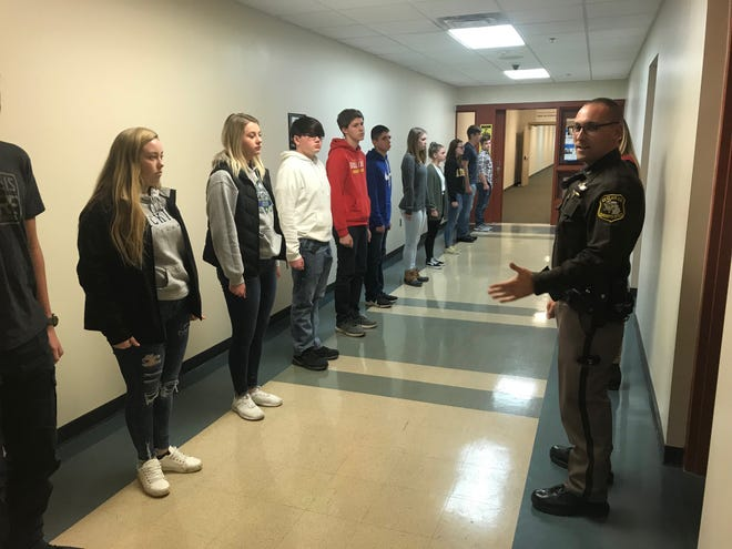 St. Clair County Sheriff Deputy Carl Wilczak teaches students police marching techniques in a meeting for the newly resurrected St. Clair County Explorer's Post.