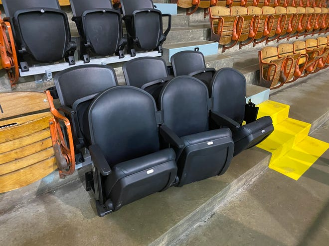 New seats from the Palace of Auburn Hills are shown next to the old, wooden seats at McMorran Place Arena. Port Huron received a 3,000-seat donation from the now-closed former home of the Detroit Pistons