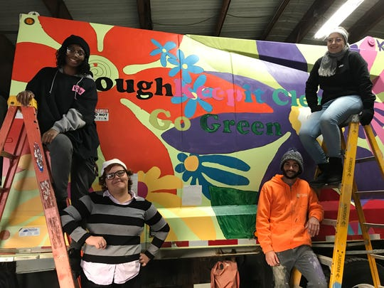 "Clockwise from top right: Tamar Towne, Dylan Scott, Aiyssa Tirado and Taaliyah Clemmons help paint the city garbage truck for the ""We're All In This Together"" public art project."