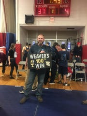 John Jay-East Fishkill High School wrestling coach Jamie Weaver poses after collecting his 100th career win.