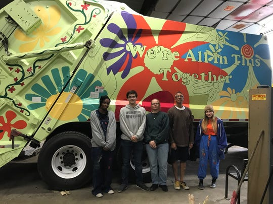 "Taaliyah Clemmons, left to right, Ryan Garcia, Lori Garcia, Joe Troche and Brittney Stewart are shown after the first day of painting the city garbage truck for the ""We're All In This Together"" public art project."