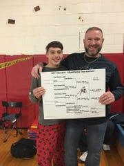 John Jay-East Fishkill High School wrestling coach Jamie Weaver poses with Tyler Albis.