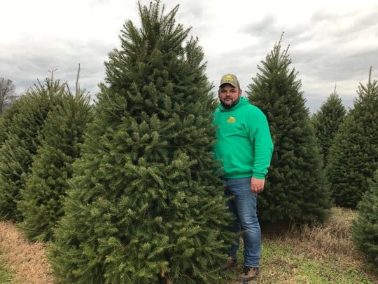Scott Etter bought the 35-acre Quality Tree Farm in 2017 and grows close to 30,000 trees across 25 acres. With nearly two seasons under his belt, Etter said he had to learn the tricks of the trade fast to be able to meet the enormous demand for trees in the local community.