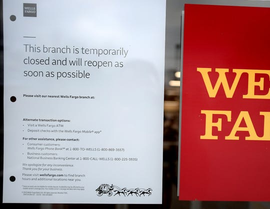 A sign on the door of the Wells Fargo Bank in the 1400 block of Loucks Road is displayed following a robbery attempt Wednesday, Nov. 27, 2019. Bill Kalina photo