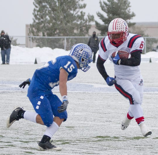 McQueen played  Liberty in a 4A State semifinal football game in 2010.