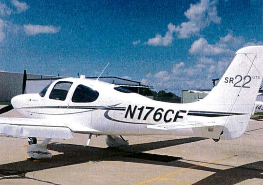 A Cirrus SR22 single engine plane is seen in Bloomington, Ill. This is the model of plane that went down by Goss Peak north of Las Vegas with three people aboard.