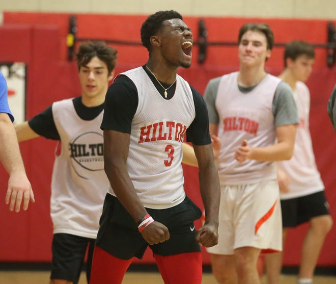 Tah'Jae Hill lets out a yell after his three-man unit won the drill contest for three defensive stops at Hilton High's varsity basketball practice at Quest Elementary School earlier this season.