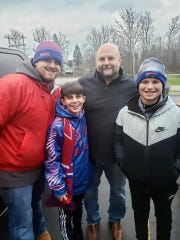 Buffalo Bills offensive coordinator Brian Daboll, second from right, gave five fans a ride to Tim Hortons after their car broke down on Nov. 24, 2019. Here, Daboll is pictured with Joe Layland, Ethan Hall and Parker Bonefede.