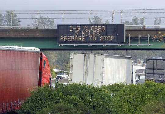 A sign above northbound Interstate 5 just north of Redding warns motorists that the freeway is closed ahead on Wednesday, Nov. 27, 2019, due to snow. The freeway closure stranded hundreds of northbound Thanksgiving travelers.